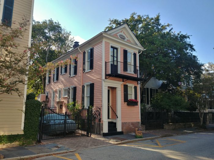 This cute pink house may be small (just over 1000 sq. ft.), but it's well situated. Located at the very bottom of King Street, if you walked out its front door and turned right, White Point Garden and the Battery would be right in front of you. Location, location, location...