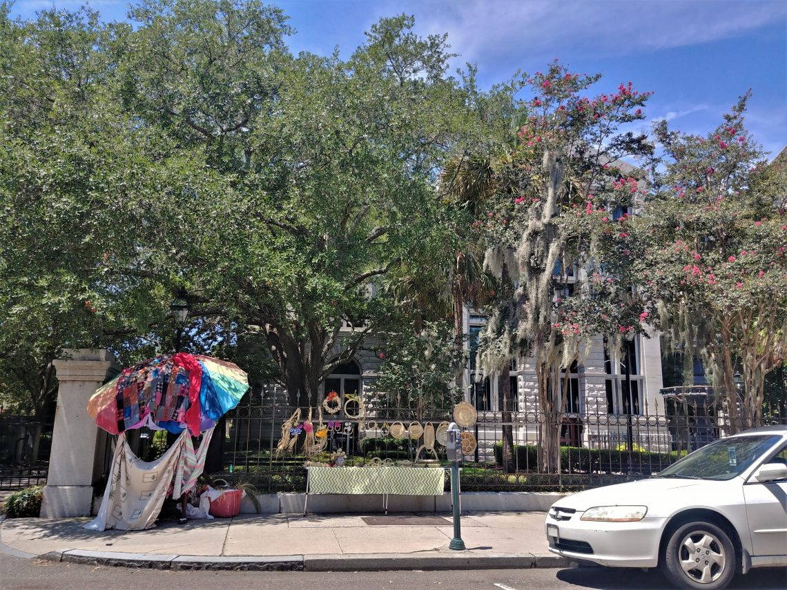 This wonder combination of Flower Lady baskets, a blooming crepe myrtle, Spanish moss, a magnificent live oak tree and a beautiful fountain is along the elegant iron fence in front of the Federal Courthouse at the Four Corners of Law. Classic Charleston.