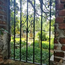 This barred view into the Circular Church's graveyard is through an old wall behind some private property on Queen Street. The graveyard is thought to be the oldest English burial ground in Charleston, with its oldest grave dating back to 1695.