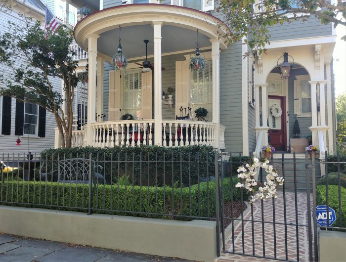 This welcoming house on lowerKing Street sports a rounded front porch -- which is less common to see in Charleston thank those incorporating right angles.