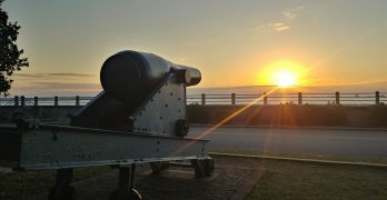 "The sunrise over Charleston Harbor, as seen from White Point Garden. This ""columbiad,"" which has been stationed at Fort Sumter, could shoot a 128 lb. shell up to 4800 yards. Now it serves as a wonderful memory-maker for all those who climb on top."