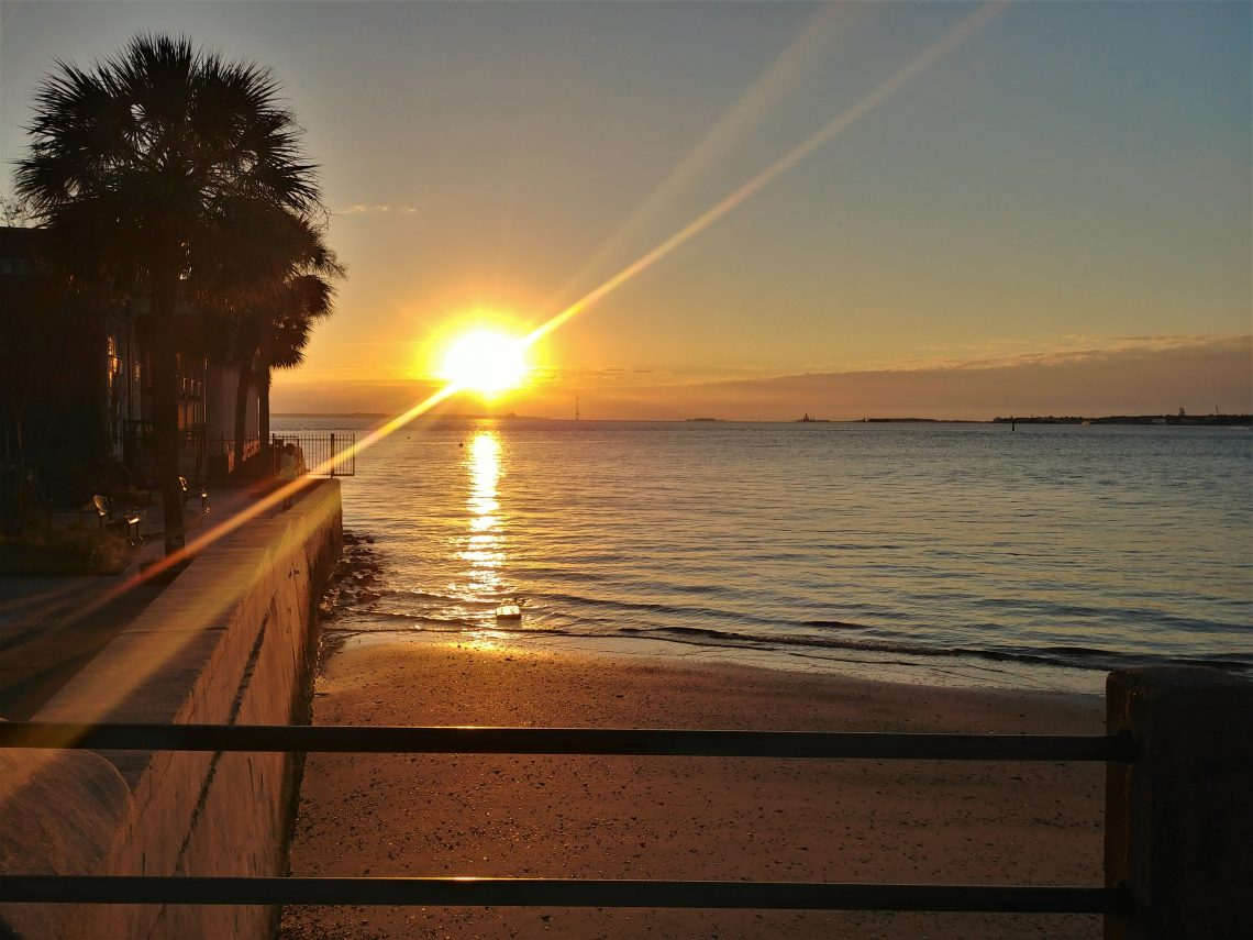 A beautiful sunrise over Charleston harbor. The building on the left, the former Omar Shrine Temple, is now an event space for the Charleston Yacht Club.
