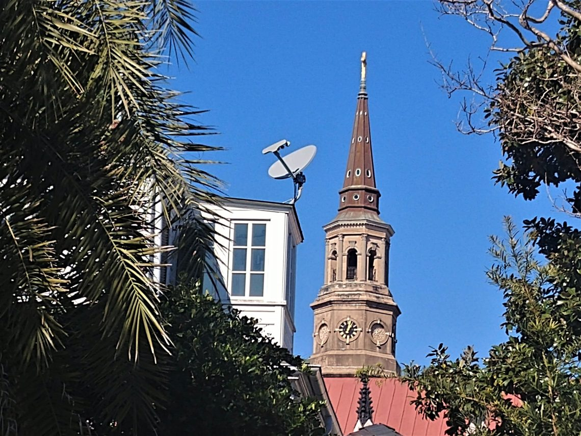 Charleston is a living city, and not a museum. The historic and the modern must, and do, coexist. Here the steeple of St. Philip's Church shares the space with some more modern technology.