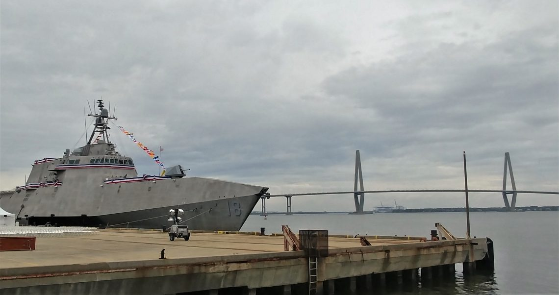 """This very cool looking """"Independence-variant littoral combat ship"""" is the 6th naval vessel to be named after the city of Charleston. It will be commissioned the USS Charleston at an event tomorrow. It looks pretty good posing in front of the Cooper River Bridge."""