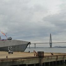 "This very cool looking ""Independence-variant littoral combat ship"" is the 6th naval vessel to be named after the city of Charleston. It will be commissioned the USS Charleston at an event tomorrow.  It looks pretty good posing in front of the Cooper River Bridge."