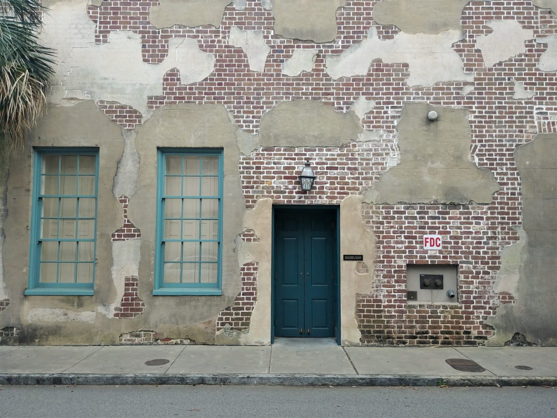 This beautiful wall and door are part of the Dock Street Theater, the oldest theater in America. This tableau is along Queen Street.