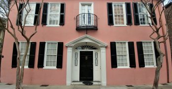 The house on Tradd Street, circa 1740, is guarded by two crepe myrtle trees -- the longest blooming plants in Charleston.