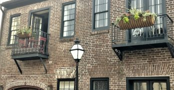 """This pretty scene is on Cordes Street, near Waterfront Park. The area, which was once home to a number of wharfs, was developed between 1790 and 1800 -- primarily by a wealthy merchant and wharf owner Samuel Prioleau (pronounced """"pray-low""""). This street was named after his wife's family."""