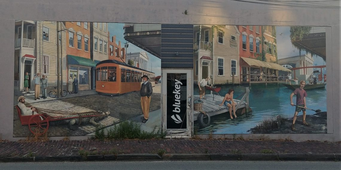 "This look at Charleston past and the possible watery future was created by David Boatwright -- the artist perhaps best known for creating Hominy Grill's ""Grits are good for you"" mural. You can find this one on East Bay Street, just below Calhoun Street."