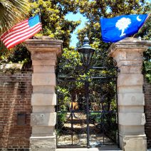 The American and South Carolina flags proudly displayed over the iconic Sword Gate.