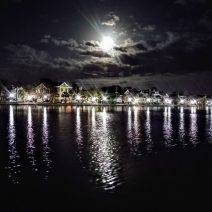 The Supermoon rising over Charleston, captured in the waters of Colonial Lake.