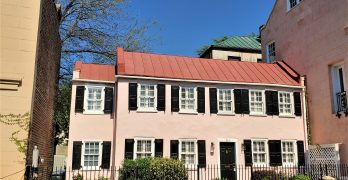 This cute little pink house, built c.1850, is located at 30 1/2 State Street in the French Quarter of Charleston.