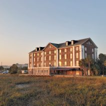 The setting sun reflecting on the historicRice Mill, located off Lockwood Boulevard along the Ashley River.