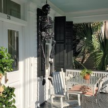 """The blue color on the ceiling of this Charleston porch is intended to ward off evil spirits known as """"haints."""" It apparently is ineffective against sparkly skeletons or skulls."""