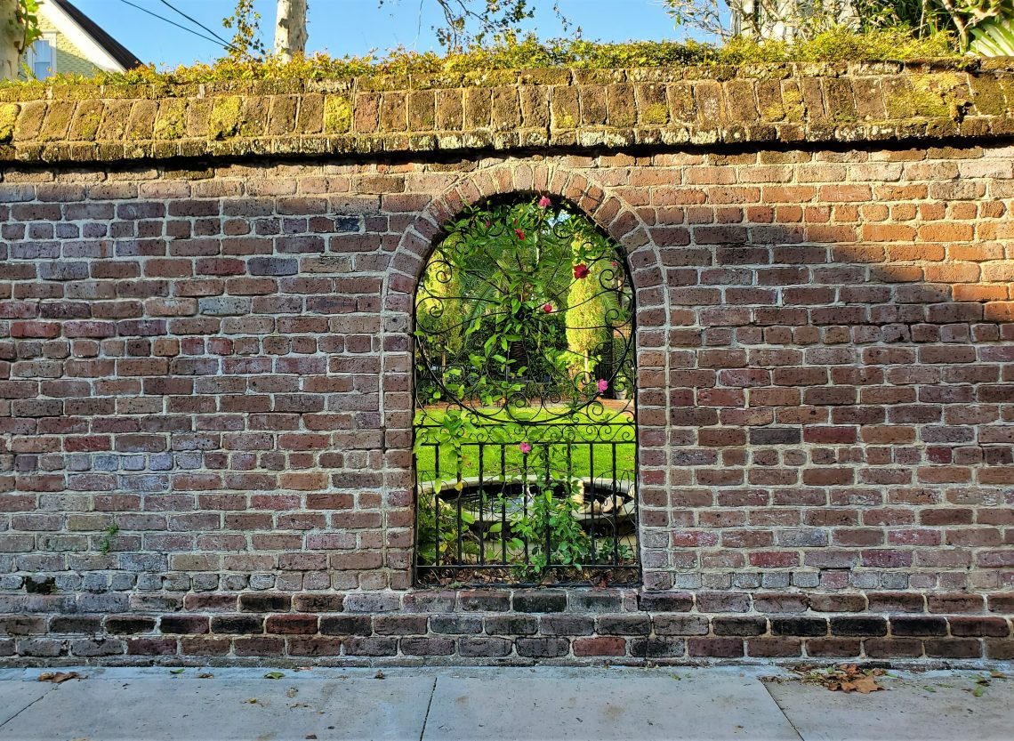 A beautiful wall, that allows a lovely view into the garden, can be found on Lamboll Street.