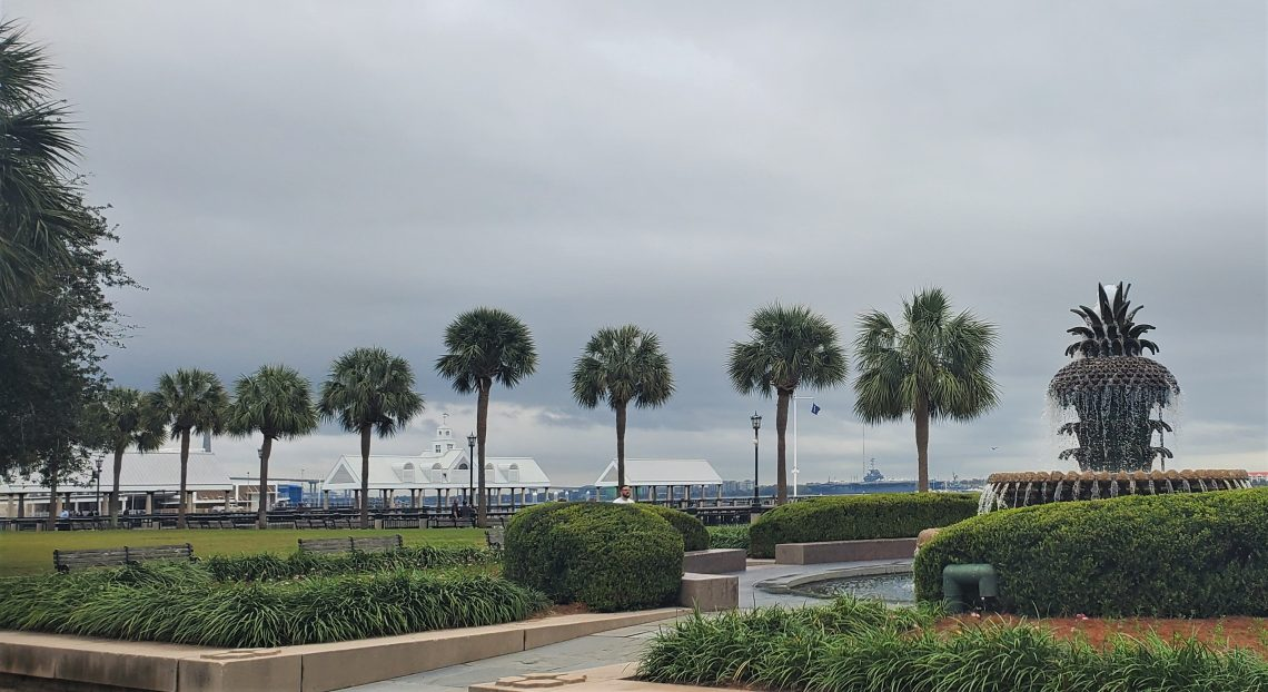 A view across Joe Riley Waterfront Park. In the distance you can see the WWII aircraft carrier the USS Yorktown, a storied fighting ship.