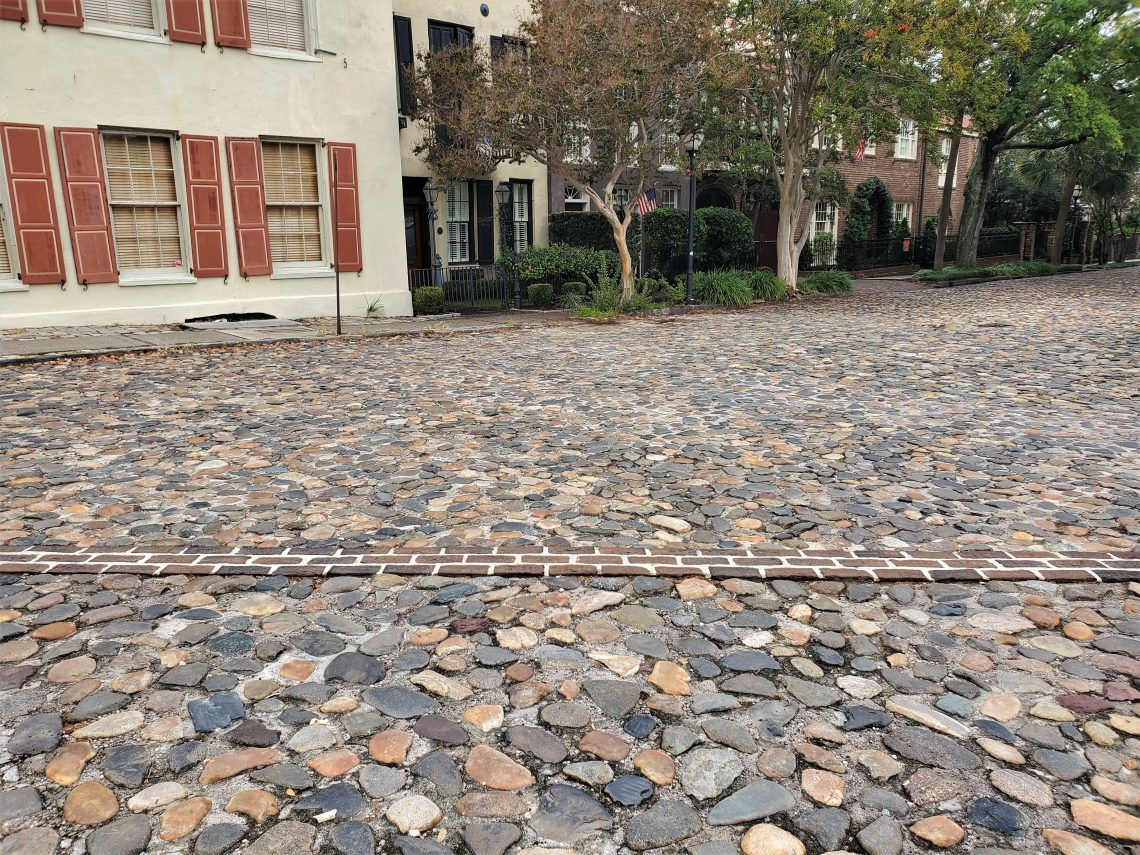 Charleston is one of the few cities in North America to ever have been a walled city. In the early 1700's, the wall protected the residents from everything from pirates to the Spaniards and French. While the wall has been mapped, there are only a few spots where you can actually see its remnants. The brick line here, across the cobbles of North Adgers Wharf, represents where the wall crossed at that point -- and if you dig down you will find it (but do not do that without permission and proper archaeological processes!)