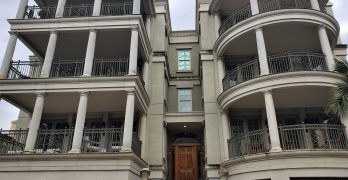 """This condo building is relatively new and can be found along the back of Waterfront Park. It is modeled after the famous """"Compromise House"""" on East Battery, where a young John F. Kennedy had an office while in the navy (before being shipped off to take control of PT-109)."""
