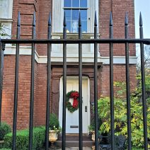 The rear of the statue in the second floor window of this imposing house on Legare Street always catches my eye, even when the house is decorated for the holidays. I often wonder if this view is intentional.