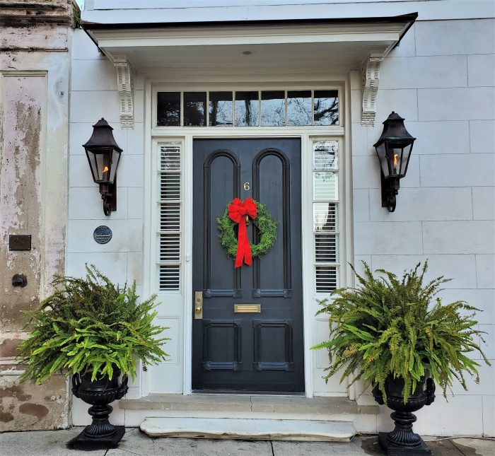 This beautiful front door scene, complete with some cool gas lights, is on Legare Street.