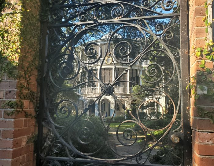 The afternoon sun lighting up the Parker-Drayton House and gate on Gibbes Street. Before lanfill was added to create the existing profile of the peninsula, the house would have had a great view of the marshes and the Ashley River.