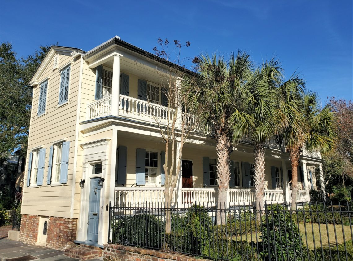 """Built in 1865 on Legare Street, this house is a great example of the Charleston single house. The main entrance is in the middle of the porch. The blue door facing the street is a """"hospitality door"""" -- which when left open indicated that the resident was receiving guests. If it was closed, you should get the message."""
