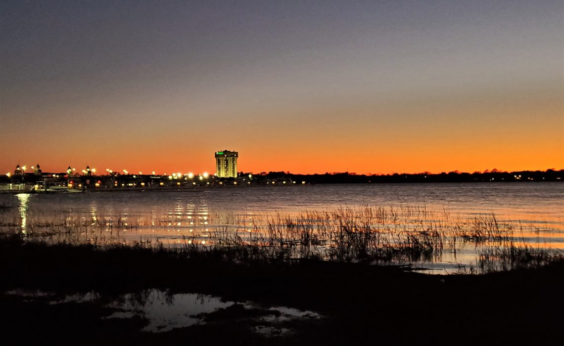 """The """"Round"""" Holiday Inn guards the southern entrance to the Charleston peninsula along the banks of the Ashley River. Beautiful at sunset, in 2018 it was named the ugliest building in South Carolina -- this was not received well by many!"""