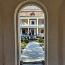 """A different view of the Joseph Manigault House through the door of the garden """"folly."""""""