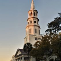 St. Michael's steeple being bathed in the light of the setting sun. The iconic white steeple wasn't always that way. During the Revolutionary and Civil Wars it was painted black, to make it a tougher target during the bombardment of the city.