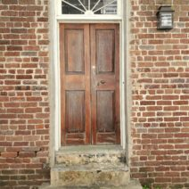 This cool door can be found on Stolls Alley -- which was once referred to as Pilot's Alley, as the ship pilots would cut through there from Church Street to get to the harbor wharves.