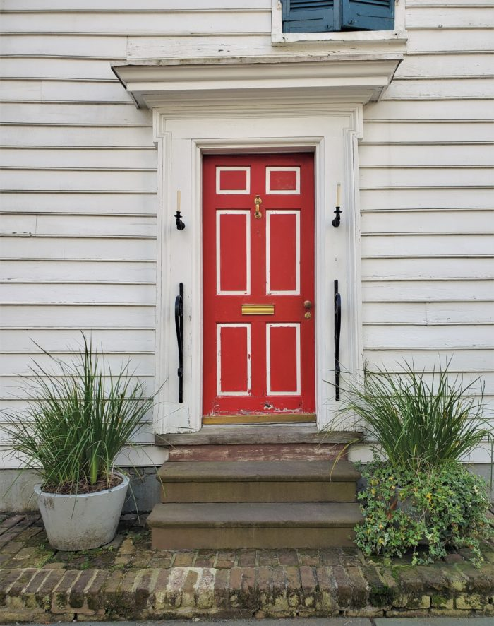"This cool door is actually the side entrance to a grand house built in 1792 on Meeting Street. It originally opened on to what was then called ""Ladson Court"" -- now Ladson Street, which is a full street connecting Meeting and King Streets."