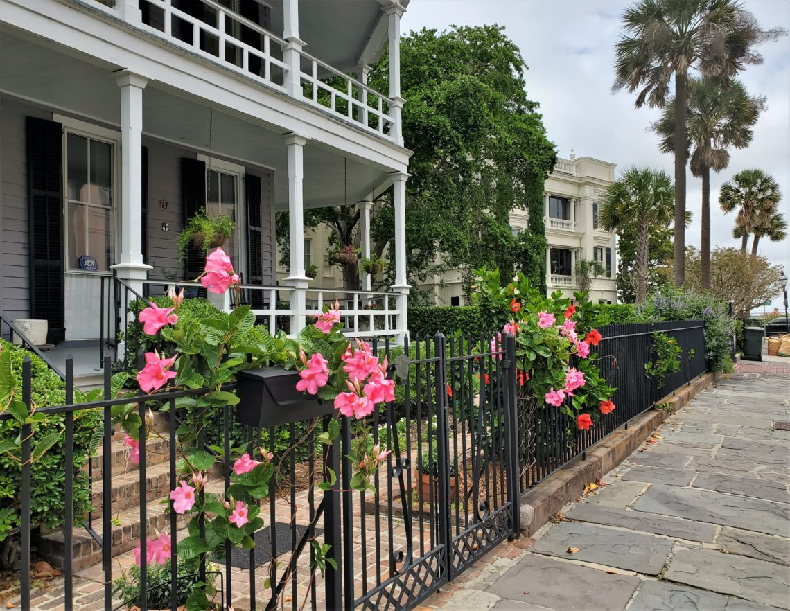 This classic Charleston scene on Atlantic Street is in front of a house that was built in 1890 -- one of two identical ones that replaced a larger house that had been destroyed in an earthquake.